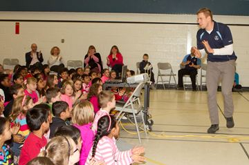 James Yurichuk, from the Toronto Argonauts Huddle-Up program speaks to the students of Alloa Public School at  an anti-bullying presentation at the school on Wednesday March 5.