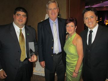 Mountainview Homes Chief Executive Officer Mark Basciano (left), Rick Podrebarac, Donna Venditti and Mike Memme with their Builder of the Year award at the Niagara Home Builders' Association Awards of Excellence on Friday, Oct. 25.
