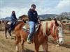 big riders on big horse