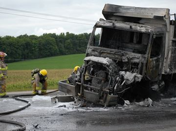 Dump truck bursts into flames after Innisfil collision