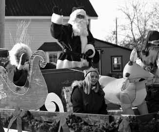 Residents lined the sides of Osgoode Main Street on Dec. 7 to take in the floats, fun (and tossed candy) of the Osgoode Santa Claus Parade. Here, the star attraction glides by at about four kilometres per hour.
