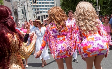 Sophie Gregoire Trudeau and her husband, Canadian Prime Minister Justin Trudeau, react to a pair of drag queens, while taking part in the annual Halifax Pride Parade on Saturday, July 22, 2017. THE CANADIAN PRESS/Stringer