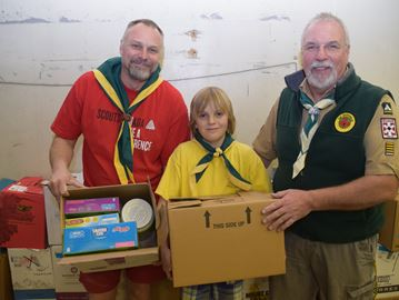 Scouts and Guides collect record amount in cash donations in spring food drive