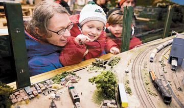 Tara Zwolinski, left, and her children Joseph and Madeleine get a closer look at the rolling stock during the Scarborough Model Railroaders' open house on Sunday.