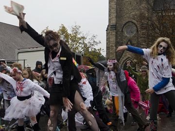 Dance artist Michele Hopkins lead a group of zombies in a re-enactment of Thriller at the Cambridge Farmers' Market.