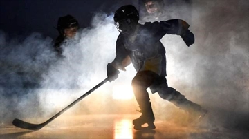 A player skates on the ice, ready for Super Saturday, the minor hockey league championships in the city.