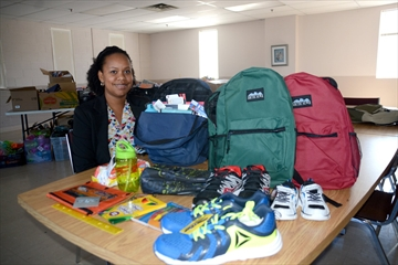 Nicole Sutherland, client services coordinator for Community Care of West Niagara, is preparing for the organization's distribution of its backpacks, shoes and supplies for its back-to-school campaign. Community Care is making a last call for any contributions of supplies or monetary donations to help fill the backpacks prior to the start of distribution on Aug. 22.
