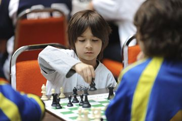 St. Cyril Catholic School student Jean-Paul Passarelli makes a move during the Toronto Catholic District School Board Team Chess City Finals Friday. Passsarelli's team from St. Cyril finished in first, Monsignior John Corrigan in second and St. Robert in third.