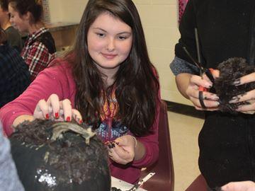 Tosorontio students decorating pumpkins