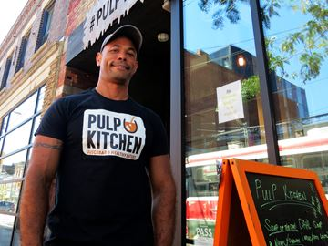 Pulp Kitchen's owner Alexandro Francisco de Oliveira, outside the juice bar's new location at 689 Queen Street East.