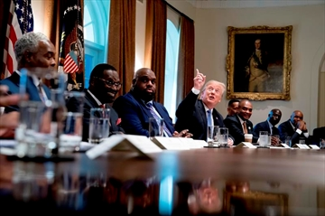 U.S. President Donald Trump, seen here during a meeting with inner city pastors at the White House August 1, is now up to 2,291 false claims for the first 563 days of his presidency, an average of 4.1 per day.
