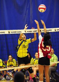 St. Philip Neri Catholic School's Lowella C. goes up for the block against a St. Robert Catholic School attacker during Toronto Catholic elementary school girls' volleyball championship action at Humber College on Thursday.