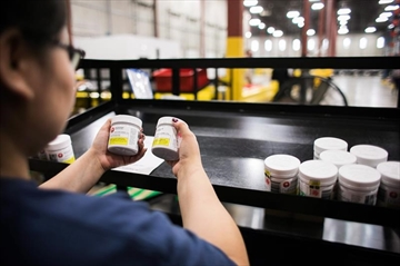 A worker examines cannabis products at the Ontario Cannabis Store distribution centre in an undated handout photo. THE CANADIAN PRESS/HO-Ontario Cannabis Store, *MANDATORY CREDIT*