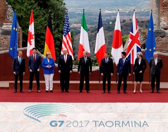 In this May 26, 2017, photo, leaders of the G7, from left, European Council President Donald Tusk, Canadian Prime Minister Justin Trudeau, German Chancellor Angela Merkel, U.S. President Donald J. Trump, Italian Prime Minister Paolo Gentiloni, French President Emmanuel Macron, Japan's Prime Minister Shinzo Abe, British Prime Minister Theresa May and European Commission President Jean-Claude Juncker pose during a group photo for the G7 summit in the Ancient Theatre of Taormina ( 3rd century BC) in the Sicilian citadel of Taormina, Italy. THE CANADIAN PRESS/AP/Andrew Medichini