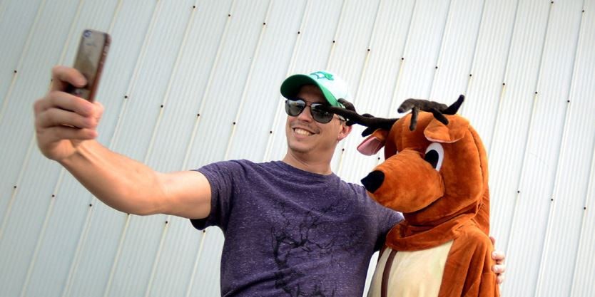 Matt McCartney stops for a quick selfie with one of the fair mascots.