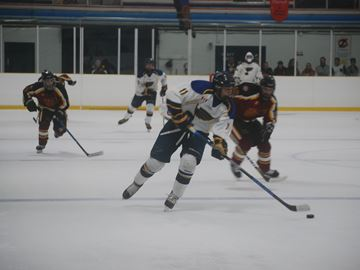 Dundas Blues forward Jeff McDonough brings the puck into Grimsby's zone during season opening junior hockey action at Westoby Ice Surface in Dundas, Thursday night. McDonough scored a goal and added two assists in the 4-2 win.