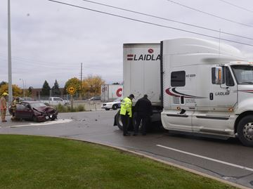 Car, transport truck crash in Burlington sends three to hospital