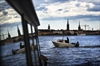 A passing boat and Stockholm's Old Town are seen reflected in the window of a ferry during a water tour of the city in Stockholm.