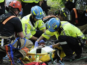 Paramedics assess injured girl