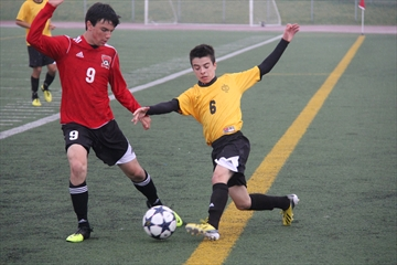 The St. Marcellinus Spirit hosted their fifth annual Friday Night Lights soccer triple header last night. The Spirit's Nick Tsekouras and Stephen Cherkas of the Philip Pocock Pirates compete for the ball in the junior boys' contest.