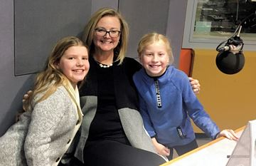 Ella Millar, 10, Clare Freeman, executive director of Dr. Bob Kemp Hospice, and Aimee Cowan, 9, stepped up to the microphone recently to record a radio public service announcement about a fundraiser for Camp Erin Hamilton.
