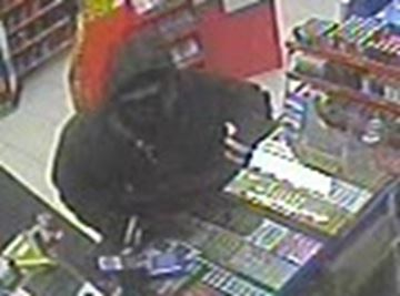 Police search for suspect in armed robbery