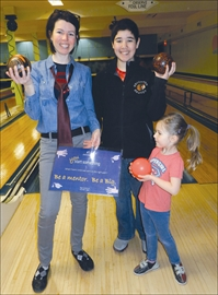 Arlene Coculuzzi, executive director of Big Brothers and Big Sisters of Hastings and Prince Edward Counties, poses with her daughter Giada, five, and Ryan Smith, 11, of Trenton at Club Medd on April 13, where 30 volunteers signed up for the annual Bowl for Kids Sake fund-raiser.