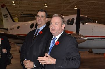 Minister James Moore, left, and MP Jay Aspin in the hanger at Canadore College's aviation campus.