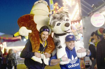 Kyle Summerfeldt (left) and Jason Brumwell show off their winnings during the 163rd Schomberg Fair May 24.