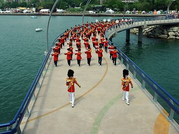 Here, the Burlington Teen Tour Band walk along the pier.