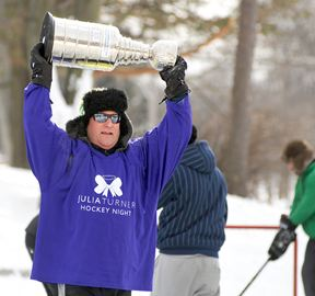 John Clark hoists the Julia's Hope Cup and skated around during the semis.