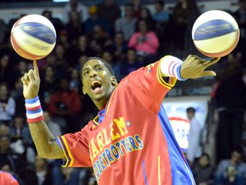 "Harlem Globetrotter Bull Bullard spins two balls on two fingers during 2014 ""Fans Rule"" World Tour at Budweiser Gardens on Thursday (April 17)."