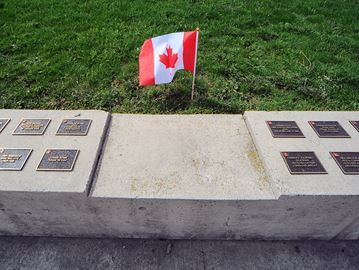 About 140 memorial plaques, replacing engraved bricks that had worn away, were unveiled Saturday at Peace Memorial Park.