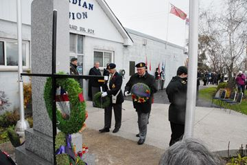 Ruth Brooks (left) and Bert Hogg lay wreaths during the Remembrance Day service at the Bradford Legion Sunday.