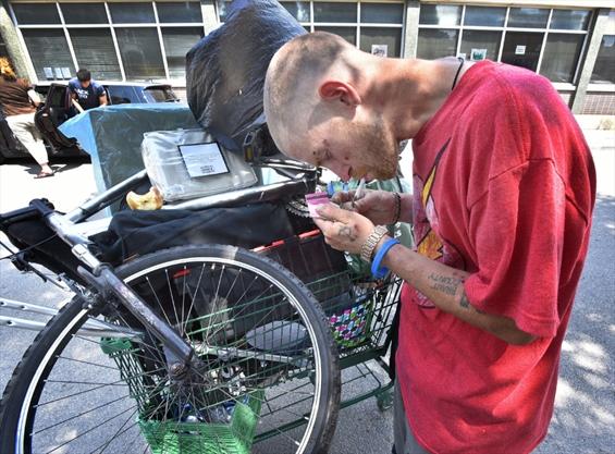 Matthew Edgeworth with his cart of belongings and scrap metal.