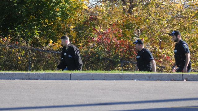 Police searching around Tim Horton's