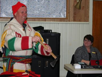 Mike Procter shows the proper technique for paddling with a tomahawk to Central Frontenac Council.