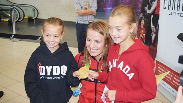 Olympic champion Erica Wiebe arrives at airport
