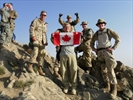 Hunter proudly hoists Canadian flag during peace keeping mission