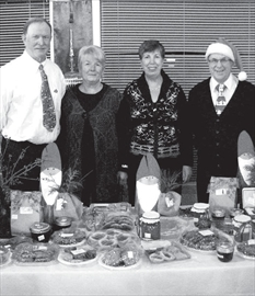 The Arnprior Curling Club held its Santa's on the Runway Tea fundraiser Nov. 23, and this first- time event drew a good crowd. Ready to say 'hello' with a good table of appetizers as people made their way upstairs, from left, are Harvey Leeman, Jackie Leeman, Runway Santa Tea organizer Joan Wahay and Rod McCallum.