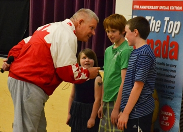 Muskoka Beechgrove Public School students, left to right, Kara Claude, Jacob Loader, and Wesley Verge, took a little advice from motivational speaker Chris Robertson during a presentation at the school on May 27.