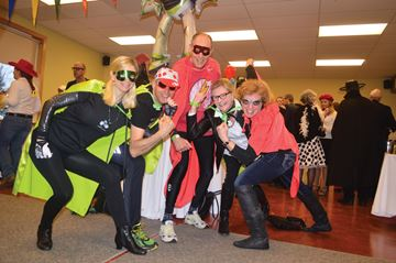 CAPED CRUSADERS.  Jane Golsby, Andy Zeltkans, John Hiley and Ellen Yeo get into their superpeople pose at the Villians and Heros Gala Event at the Port Carling Community Centre on Saturday, April 12. (Photo by Bev McMullen)