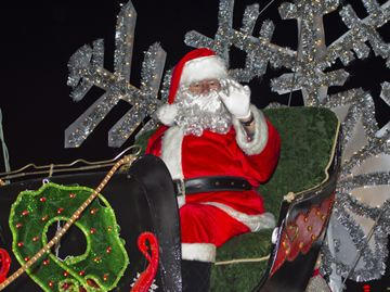 Santa waves to the crowds from his float.