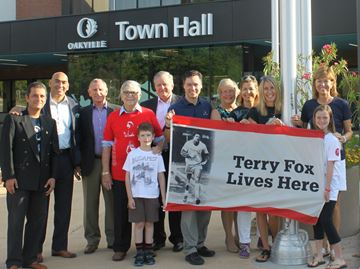 Town Hall raised a flag Monday in recognition of the upcoming Oakville Terry Fox Run on Sept. 14 at Coronation Park.