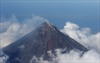 Lava flows from Philippine volcano, thousands flee-Image1