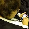 Trustee plays Words with Friends at meeting