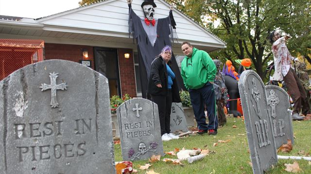 Halloween is a family affair for Celine Chartrand-Thorn, left, sons Mathieu, 17, and Riley, 10 and her husband Brian Thorn. Since moving into the neighbourhood three years ago, they have decorated their home at 1929 Dauphin Ave. in the lead up to Halloween
