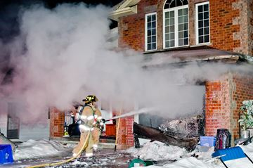 Blaze along Simcoe Road contained to garage