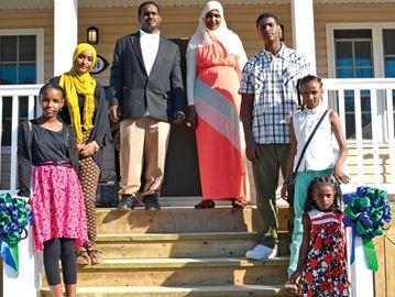 Osman family celebrates completion of Habitat home