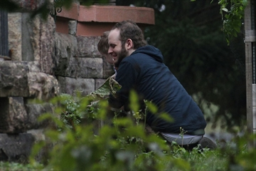 Joshua Boyle and his son Jonah play in the garden at his parents house in Smiths Falls, Ont., on Saturday.